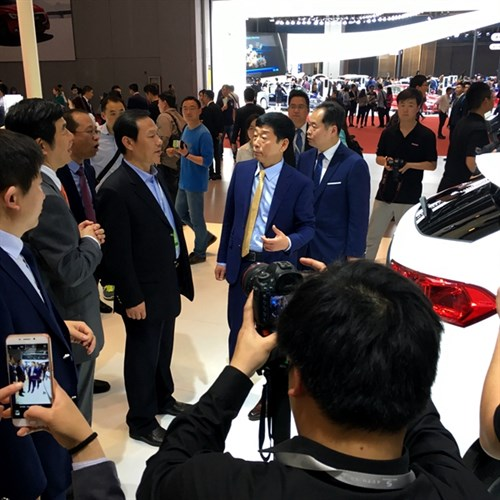 Great Wall Motors Founder and Chairman Wei Jianjun introduces WEY VVT7 to an unnamed VVIP visitor