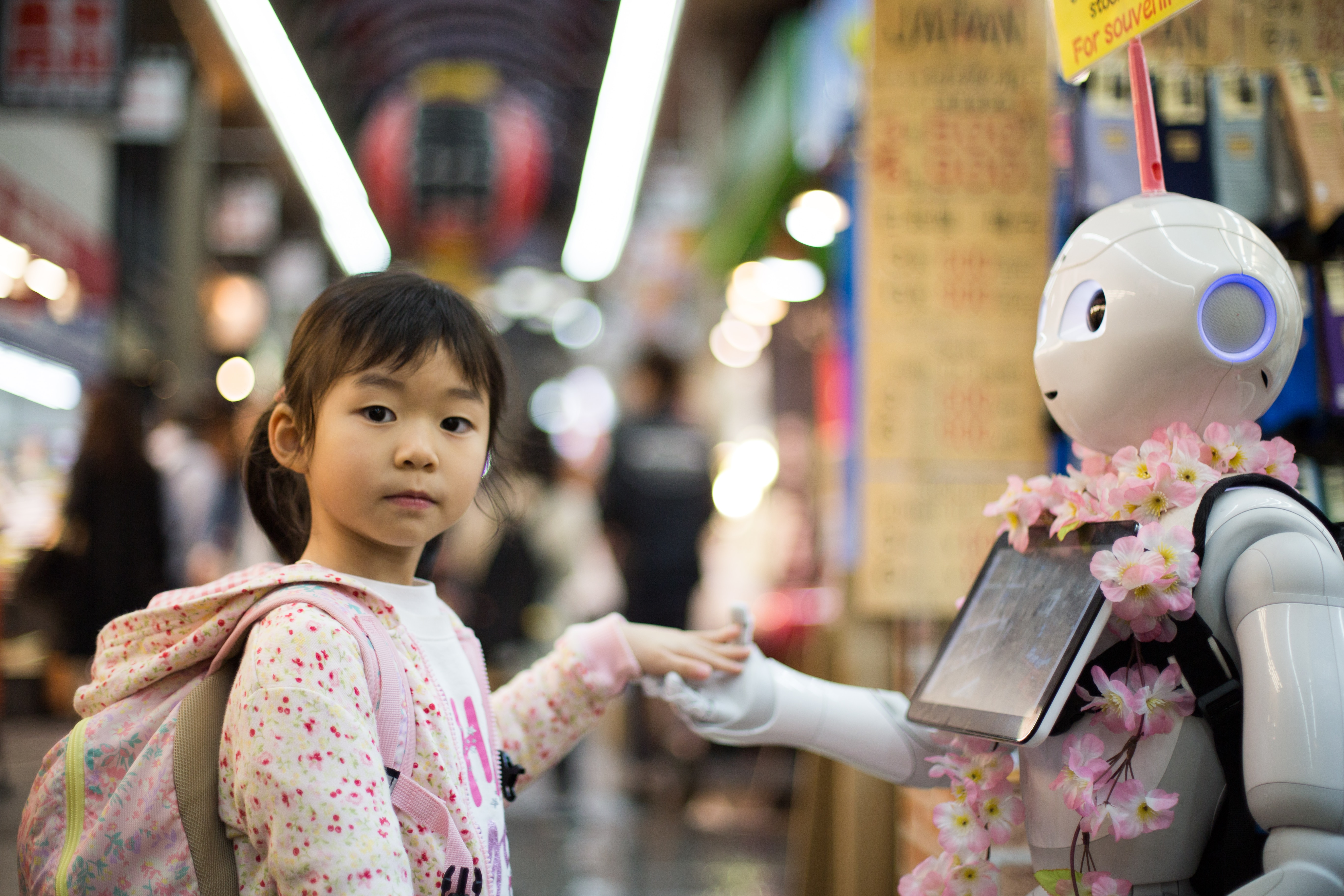 Young girl with robot