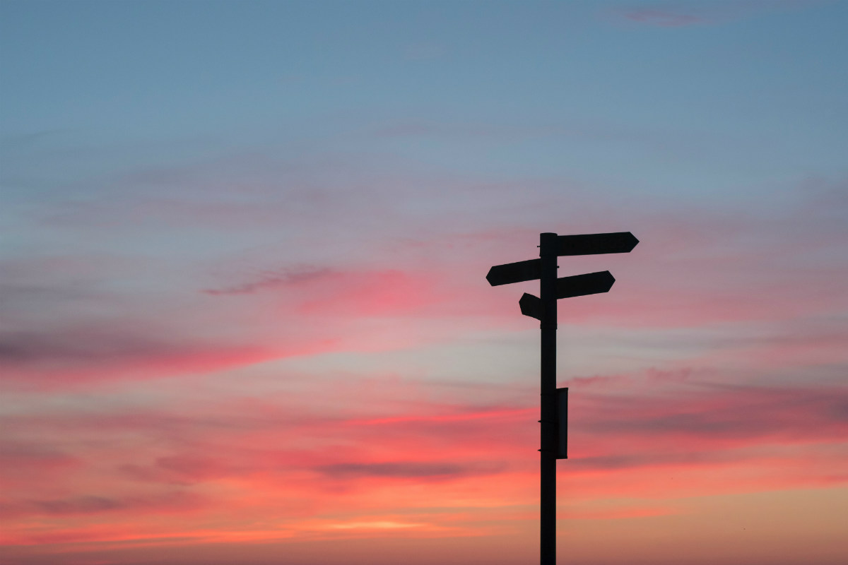 Signpost against a sunset backdrop
