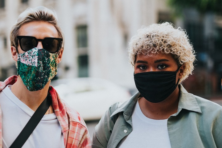 Two people with masks on