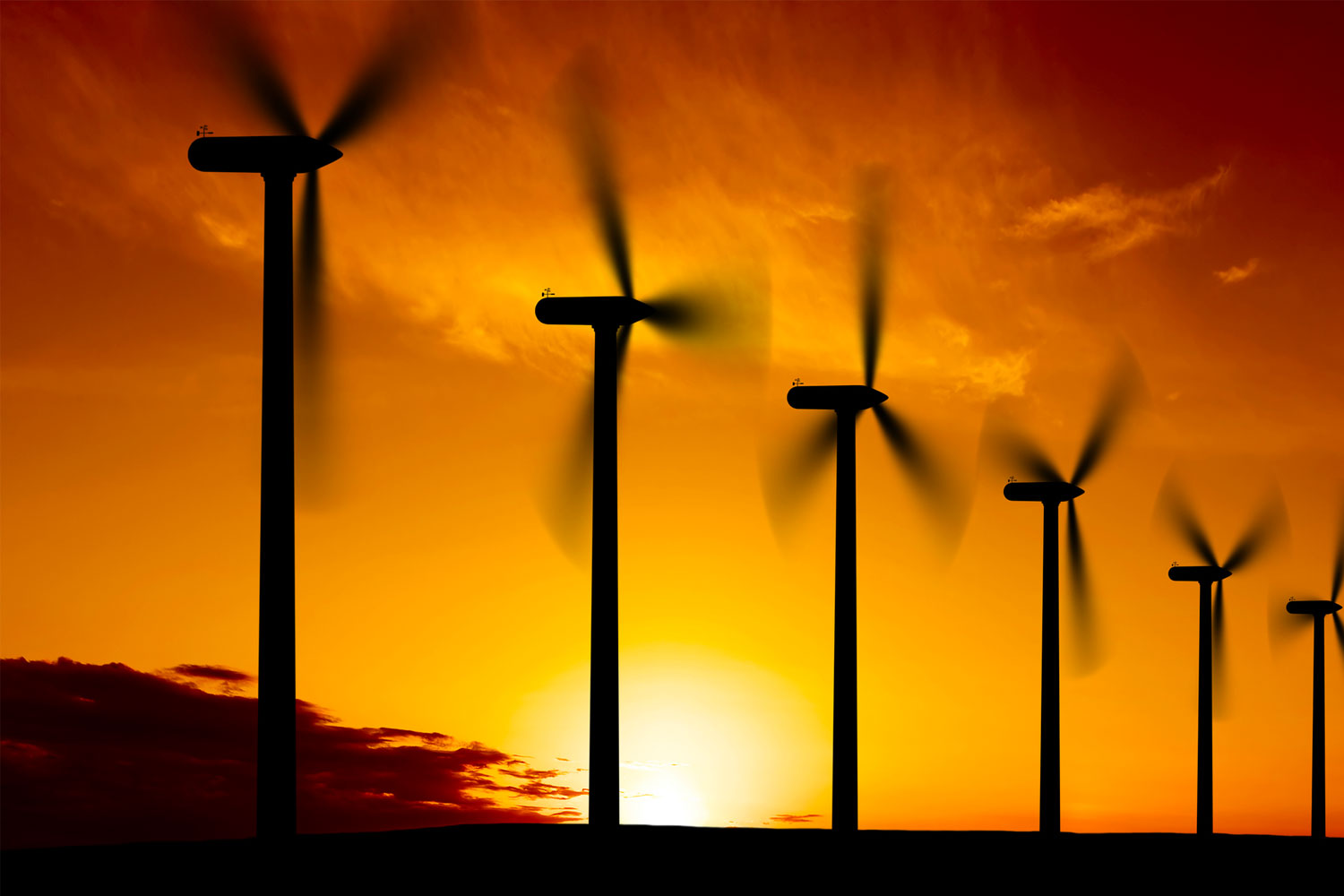 Wind turbines with sunset