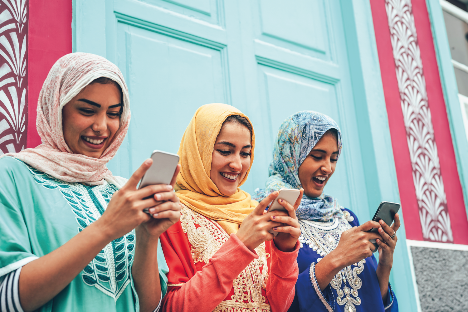 Women in hijab using smartphones
