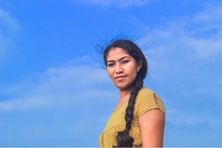 Woman in Sri Lanka against blue sky
