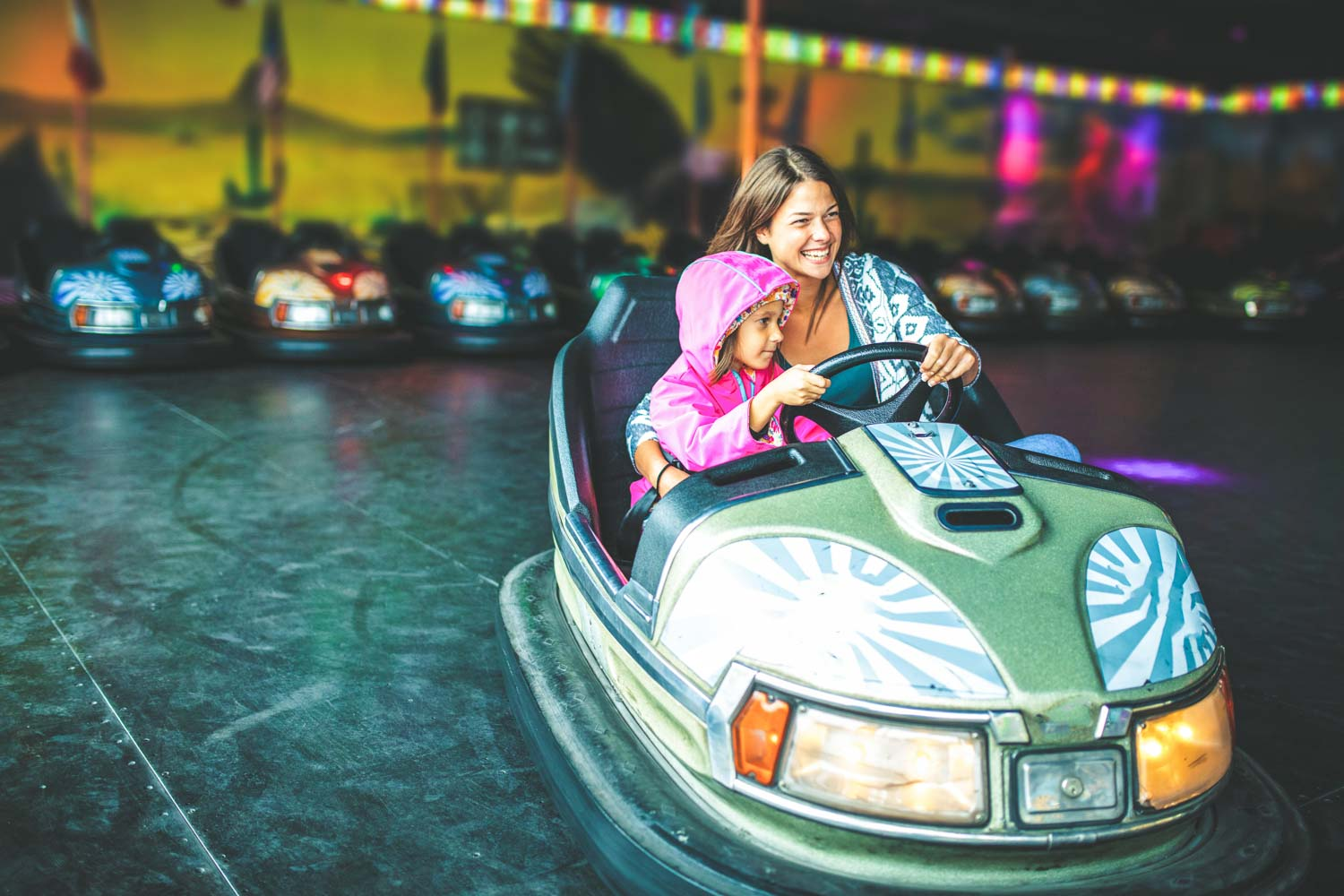 Mother and child in bumper car