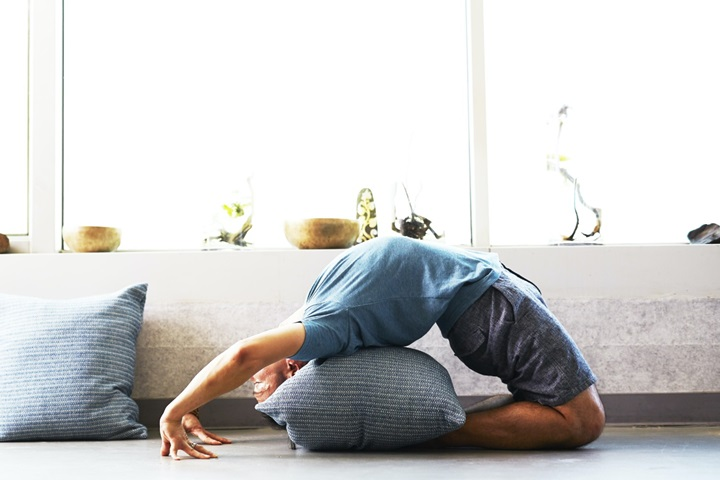 man doing backbend yoga