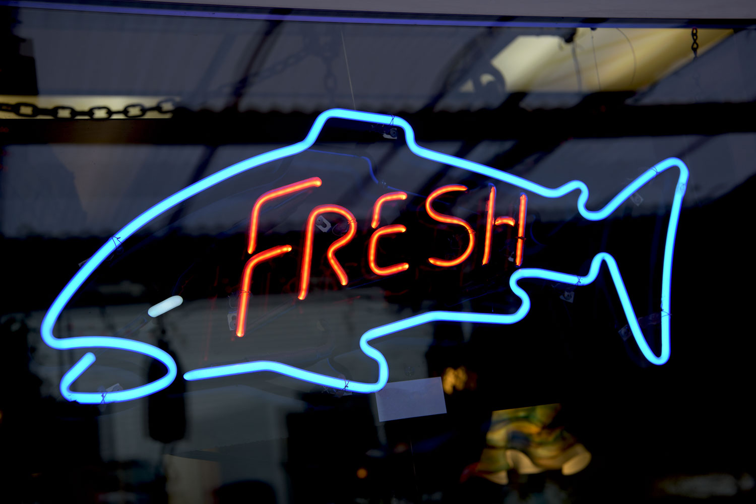 Neon fishmonger sign