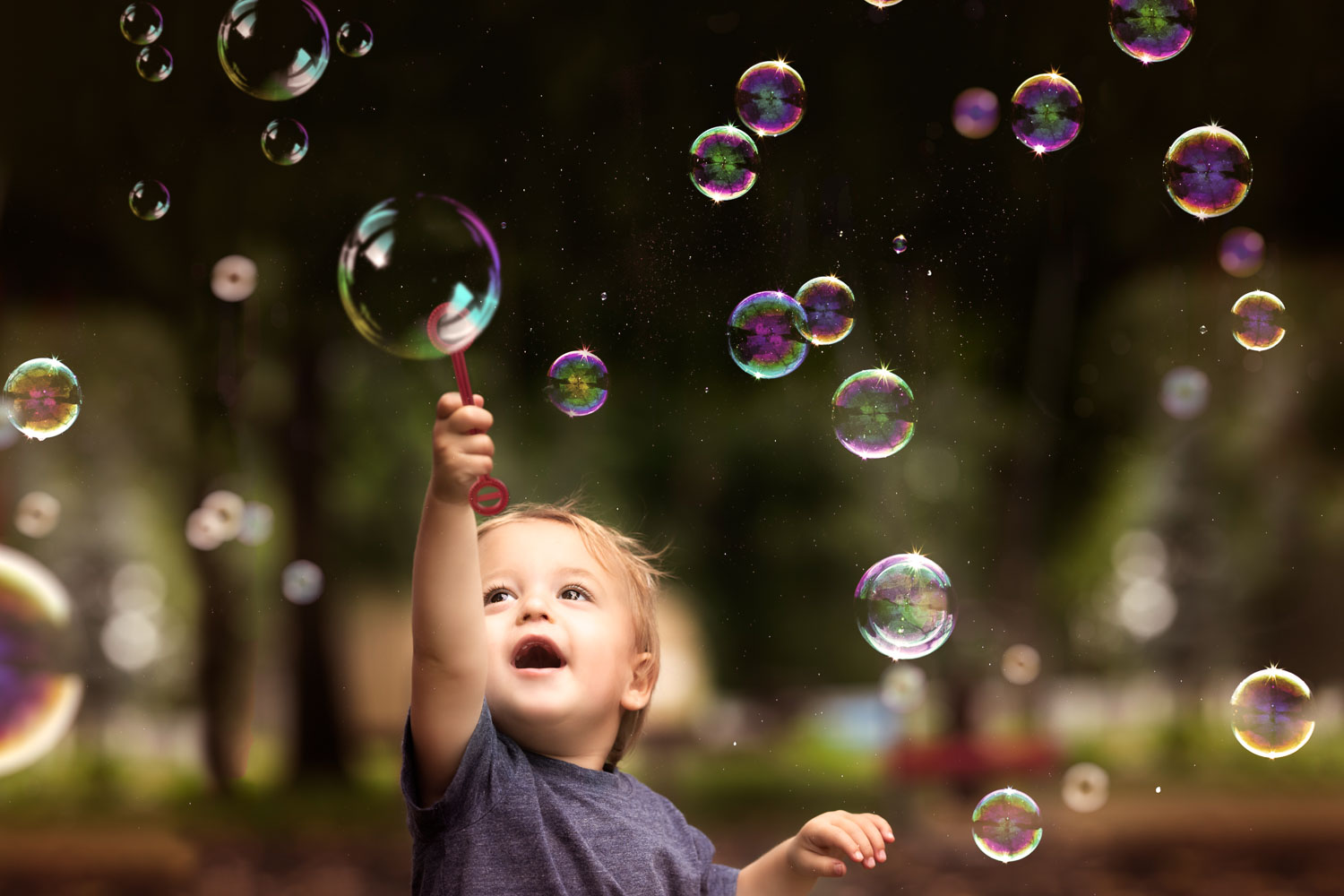 Child pointing at bubbles